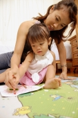 Mother and child drawing with crayons - Alex Microstock02