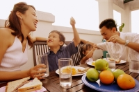 Family having a meal together - Alex Microstock02