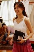 Woman standing in bedroom, man in the background bending forward - Alex Microstock02