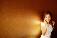 Young woman using mobile phone, smiling - Alex Microstock02