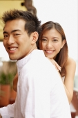 Young man in profile, young woman in front of him, smiling - Alex Microstock02