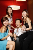 Young adults, holding drinks and smiling at camera - Alex Microstock02