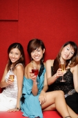 Young women, holding drinks and smiling at camera - Alex Microstock02