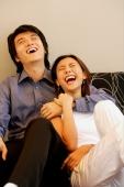 Man with arm around woman, laughing - Alex Microstock02