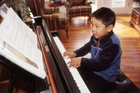 Boy playing the piano. - Mary Grace Long