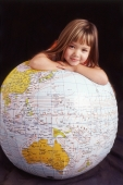 Girl leaning on globe - Mary Grace Long