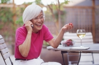 Mature woman using mobile phone, smiling - Mary Grace Long