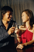 Young adults raising wine glasses, looking at each other - Alex Microstock02