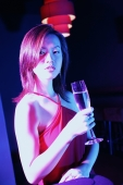 Young woman raising wine glass, looking at camera - Alex Microstock02