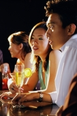 Young adults sitting at bar - Alex Microstock02
