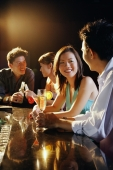 Young adults sitting at bar, talking - Alex Microstock02