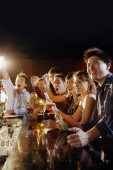 Group of friends sitting at bar, looking away - Alex Microstock02