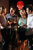 Young adults in night club, standing and holding drinks - Alex Microstock02