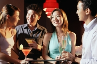 Couples in night club, holding drinks - Alex Microstock02