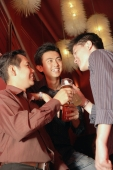Young men in night club toasting with drinks - Alex Microstock02
