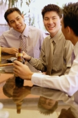 Young men at bar counter talking - Alex Microstock02