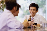 Young men at bar counter with drinks - Alex Microstock02