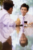 Young men sitting at bar counter with drinks - Alex Microstock02
