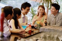 Young adults at bar counter having drinks - Alex Microstock02