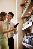 Couple selecting wine - Alex Microstock02