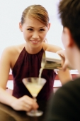 Man pouring drink for woman - Alex Microstock02