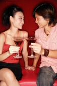 Couple toasting with drinks - Alex Microstock02