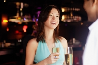 Couple standing face to face, holding drinks - Alex Microstock02