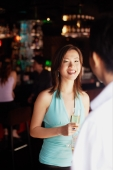 Woman facing man, holding champagne glass - Alex Microstock02