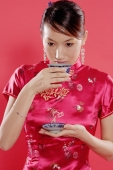 Woman holding teacup, drinking - Alex Microstock02