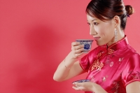 Woman holding teacup, drinking, sideview - Alex Microstock02