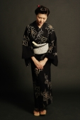 Woman in Japanese costume, standing, hands clasped - Alex Microstock02
