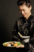 Woman in Japanese costume, holding plate of Japanese food - Alex Microstock02