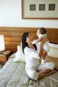 Mother carrying baby girl - Jade Lee