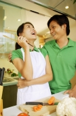 Couple in kitchen, man with arm around woman - Alex Microstock02