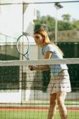 Woman holding tennis racket, playing tennis - Alex Microstock02