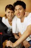 Couple in gym, looking at camera, portrait - Alex Microstock02