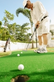 Senior man holding golf club, playing golf - Alex Microstock02