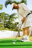 Mature man holding golf club - Alex Microstock02