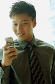 Businessman looking at mobile phone - Alex Microstock02