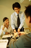 Executives having a discussion, woman using mobile phone - Alex Microstock02
