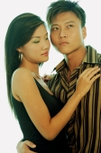 Couple standing, man with arm around woman's waist, portrait - Alex Microstock02