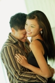 Couple hugging, woman looking away, smiling - Alex Microstock02