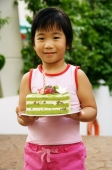 Young girl holding cake - Alex Microstock02
