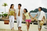 Couples on beach, walking hand in hand - Jade Lee