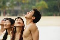 Couples standing, eyes closed, looking up - Jade Lee