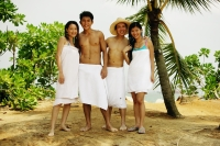 Young adults wearing towels, standing in a row, looking at camera - Jade Lee
