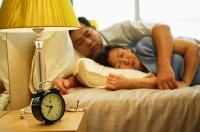 Mature couple sleeping in bedroom - Jade Lee