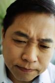 Man frowning, headshot - Jade Lee