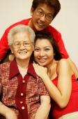Three generation family, looking at camera, portrait - Jade Lee