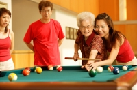 Three generation family, playing billiards - Jade Lee